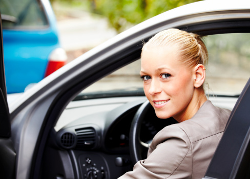 Blonde Woman Driving a Car